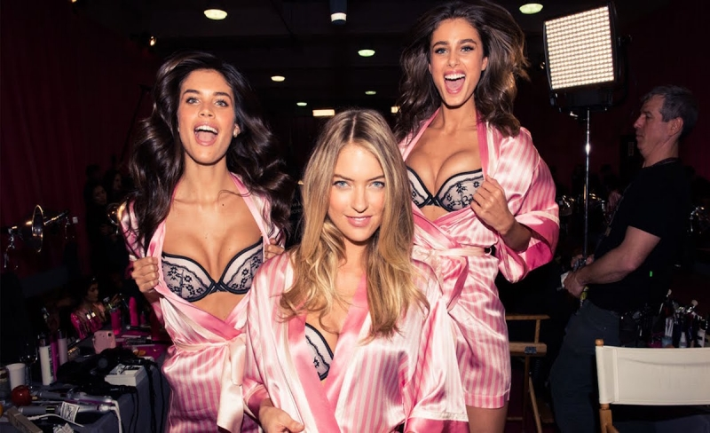 victoria secret models in their iconic pink dress gowns
